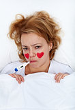 Lovesick woman with thermometer in bed