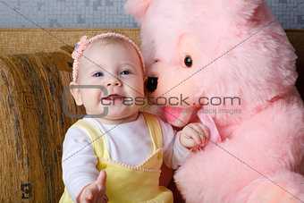 small girl and toy bear
