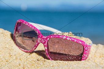 pink suglasses near the sea