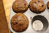 Bran muffins in tin on old table
