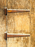 Rusty hinges on an old wooden door