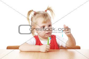 child and teeth brush