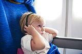 child with headphones in the plane