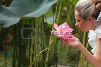 happy bride smelling a lotus