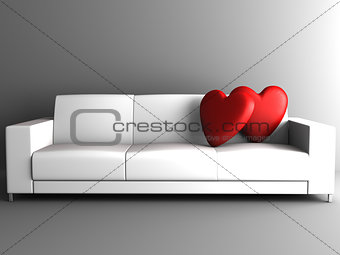 red heart on white sofa