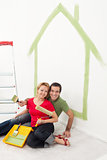 Happy couple painting in their home