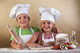 Happy kids making pizza togheter