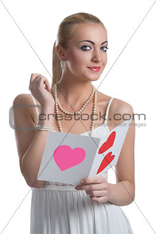 blonde girl with valentine postcard looks in to the lens