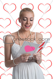 blonde girl reads valentine postcard