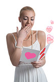 surprised blonde girl reads valentine postcard