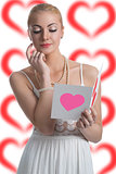blonde girl looks valentine postcard