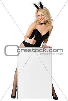 Sexy girl dressed as a playful rabbit with a poster