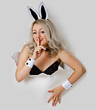 Girl - sexy rabbit playful looks from a hole