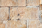 Wall built of rectangular sandstone bricks
