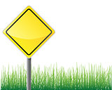 Empty traffic sign yellow color grass below.