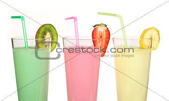 Banana, kiwi and strawberry milk shake and fresh fruis