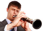 Young musician plays clarinet 