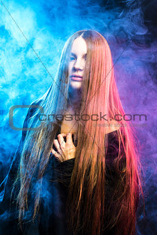 beautiful passionate girl in the smoke