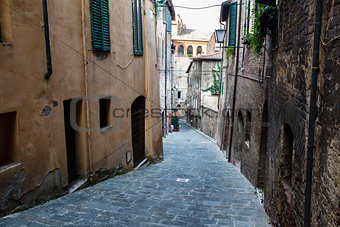Narrow Alley With Old Buildings In Medieval Town of Siena, Tuscany