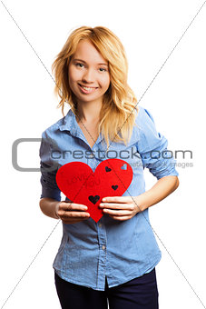 Attractive blonde girl holding red heart-shape