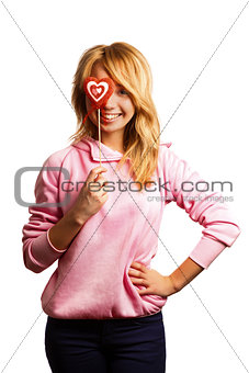 Attractive girl holding Valentine's day decoration