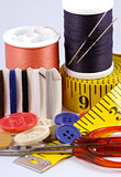 Some sewing tools such as threads, needles, buttons, and scissors