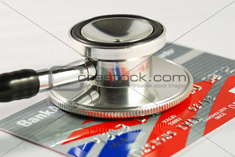 A stethoscope on the credit card concepts of checking the financial health and security