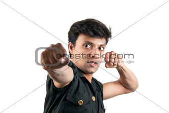 Angry Indian man in attacking position