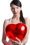 sexy brunette with heart shaped balloon looks in to the lens