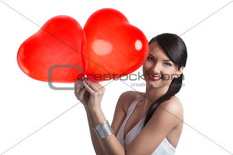 sexy brunette with heart shaped balloons smiles