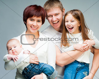 Pretty smiling family looking at the camera