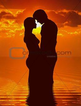 Loving couple under sunset