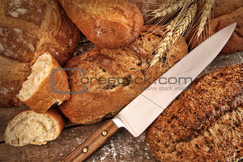 A selection of bread loaves with knife