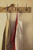 Kitchen aprons hanging on hooks with vintage feel