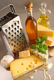 Assortment of cheeses and olive oil on table