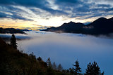 early misty sunrise in Alps