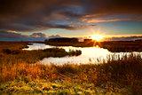 dramatic sunrise over lake