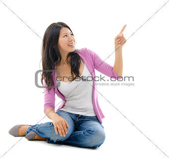 Asian woman hand pointing on blank space