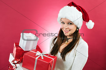 Happy girl holding christmas gifts
