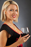 Attractive blond drinking red wine