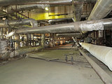 Giant pipes, tubes and equipment inside power plant, night scene
