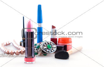 brightly colored makeup objects on white background