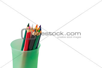 colored pencils for children in green glass