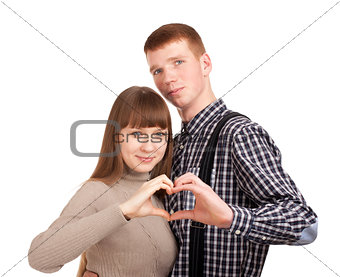 Happy couple showing heart with their fingers