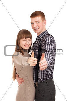 Happy couple gesturing thumbs up sign