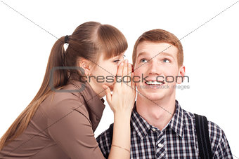 Young woman telling a secret to a man