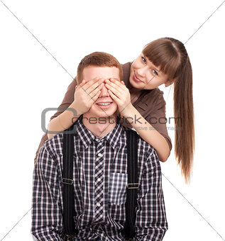 Woman covering mans eyes