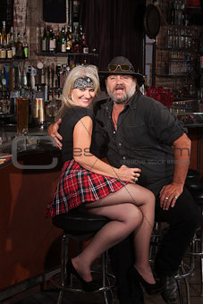 Happy Biker Gang Couple in Bar