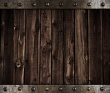wooden background with metal border and rivets