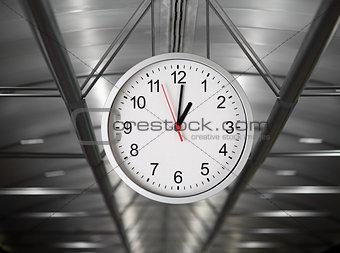 Classical simple clock hanging in industrial interior